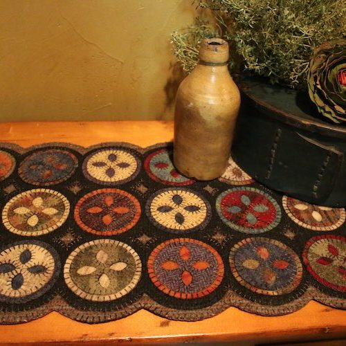 Wool applique table runner by Mary Blythe
