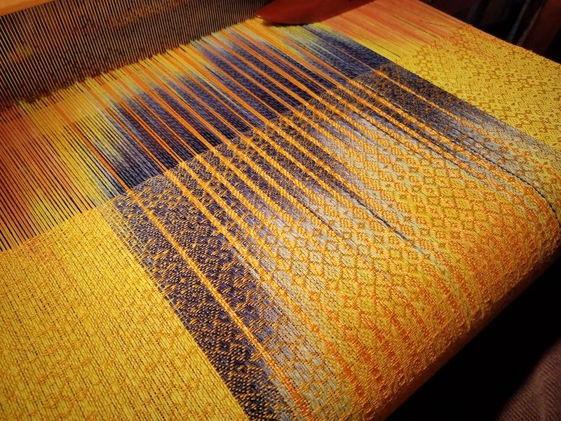 Yellow towel on loom