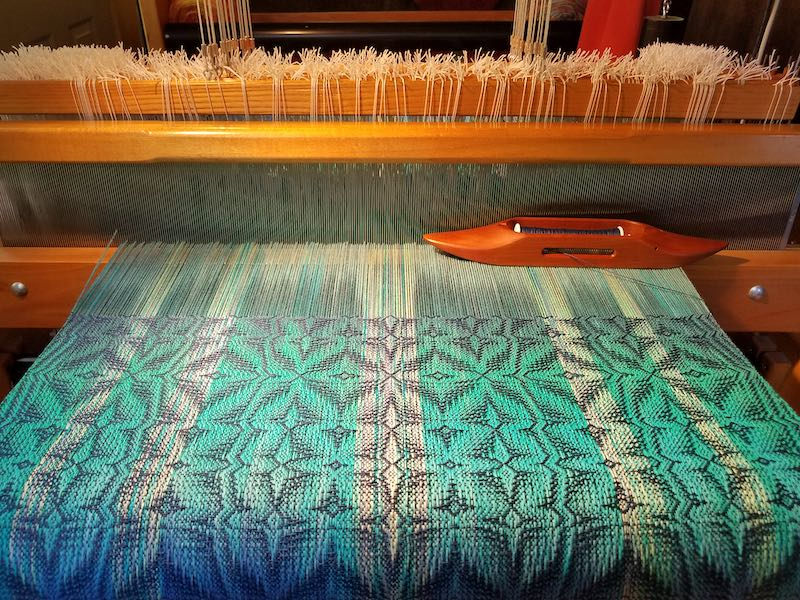 Turquoise towel on loom