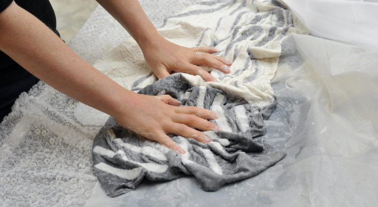 fulling a poncho in the wet felting process