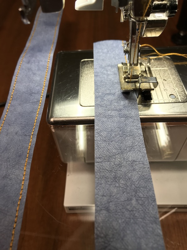 Topstitching the handles for the tote