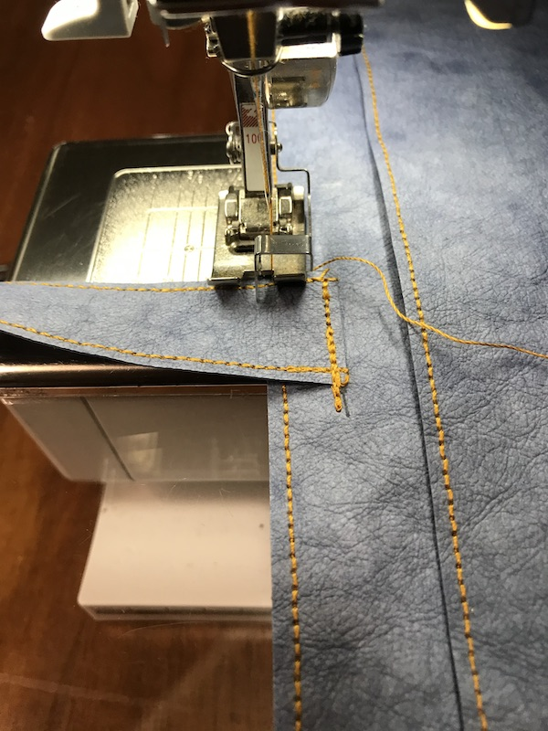 Stitching the handles on the tote