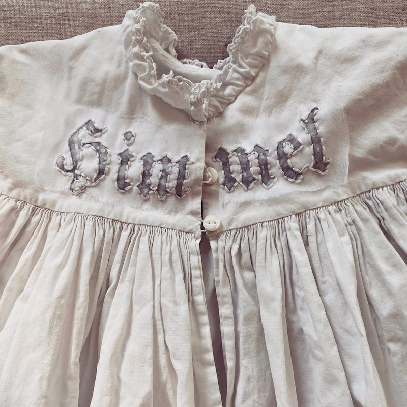Close up of embroidery on a baby dress