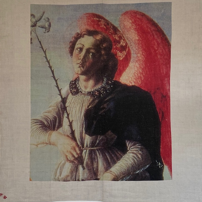 Antique needlework of an angel