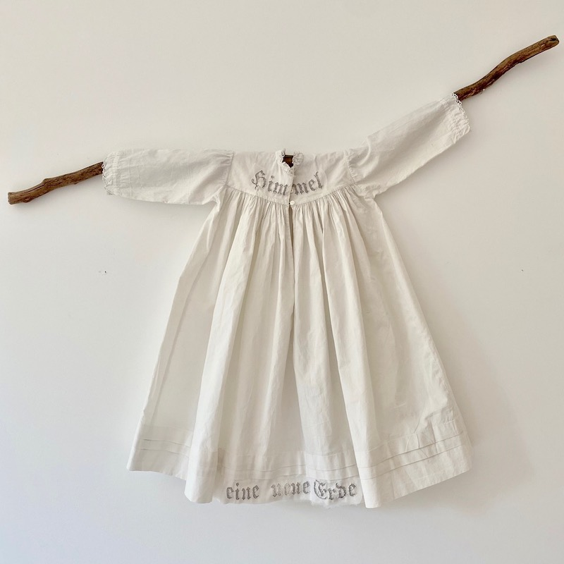 Antique baby dress displayed