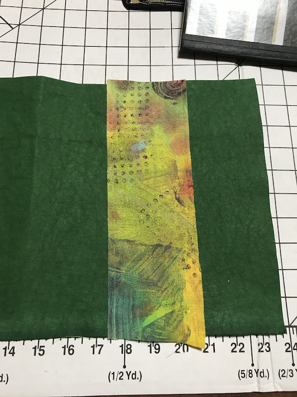 Background of pen quiver is sewn to Kraft-Tex