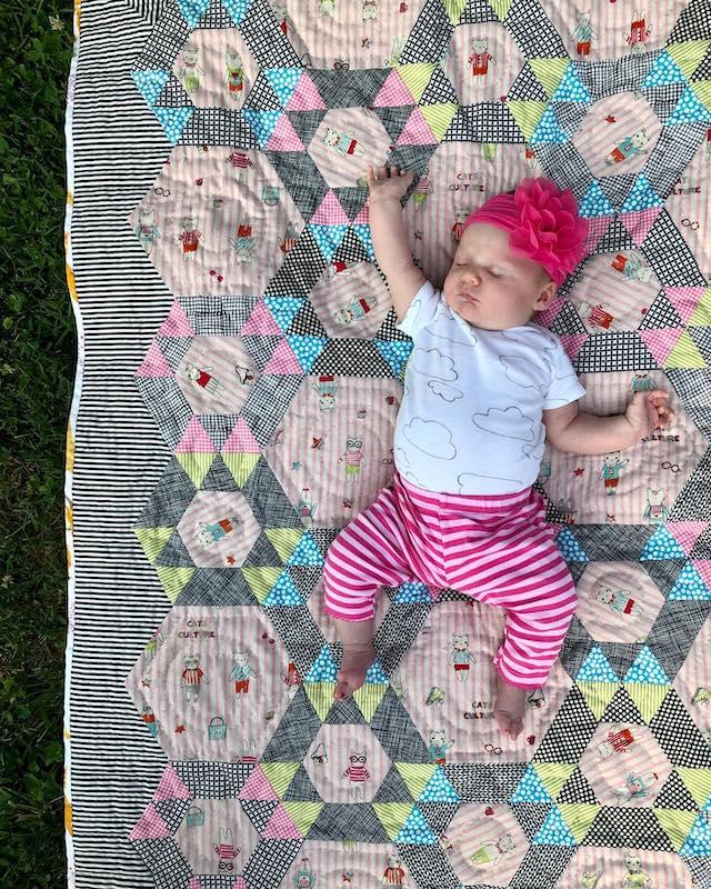 Baby Austin on a EPP quilt