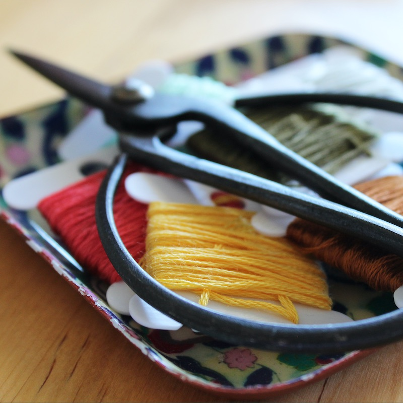 Thread and scissors ready for embroidery