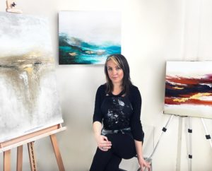 Alyson and three of her paintings