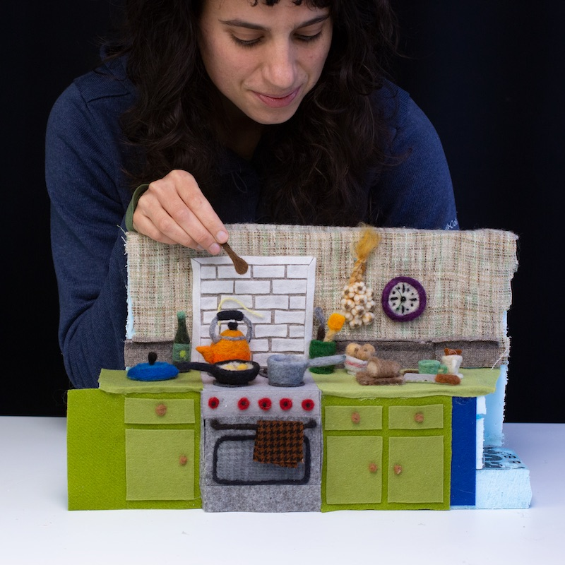 Andrea and her miniature kitchen made from wool