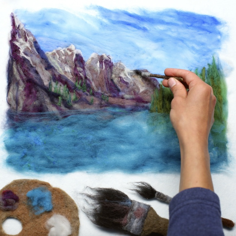 Painting a landscape with wool