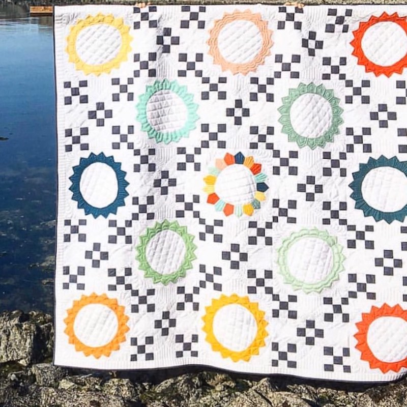 Checkered and sun quilt by Dara Tomasson