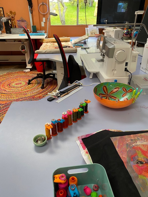 Pam's working studio, showing her thread lined up for a project