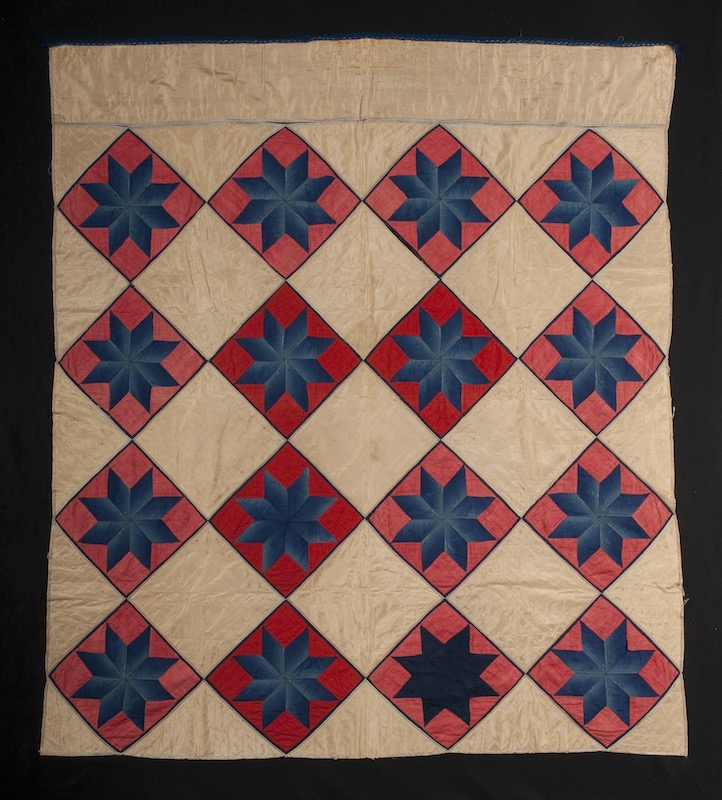 Full image of a vintage silk star quilt