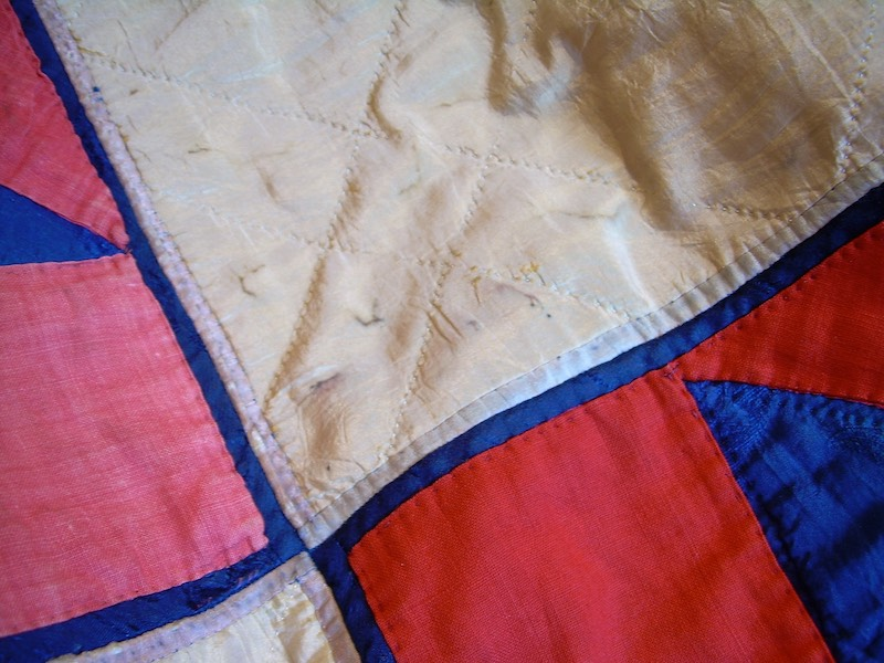 Close up of a vintage star quilt made from silk