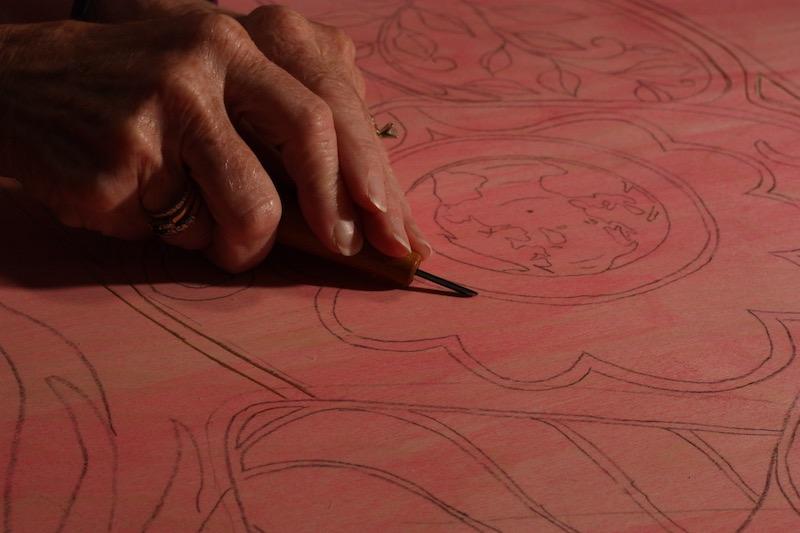 Jill carving a woodcut