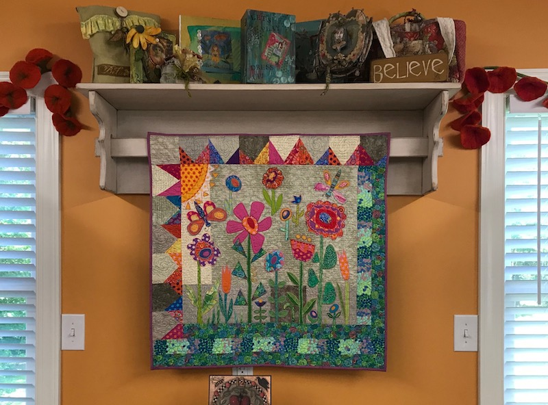 Susan's orange wall with Wildflower Meadow quilt