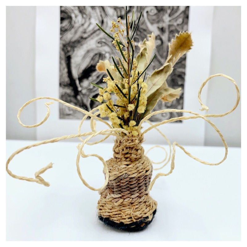 Jute vase with dried flowers and twigs