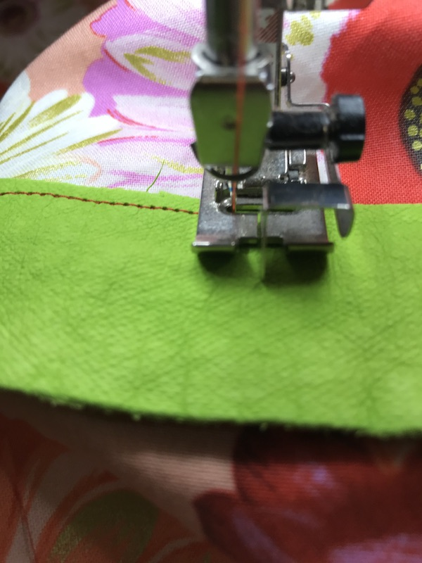 Sewing across the bottom of the zipper