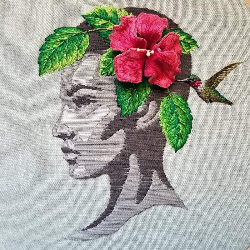 Portrait with hibiscus in hair embroidery stitched