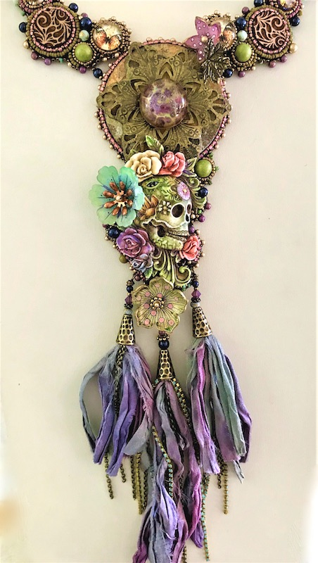 Necklace made with skulls, ribbons and flowers
