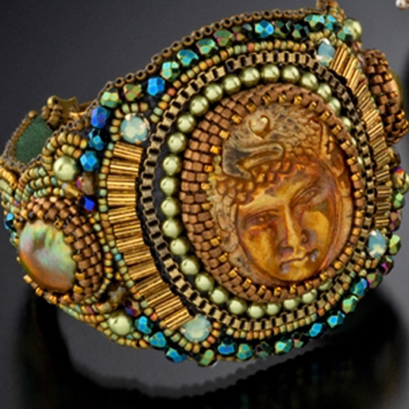 Close up of face beaded cuff