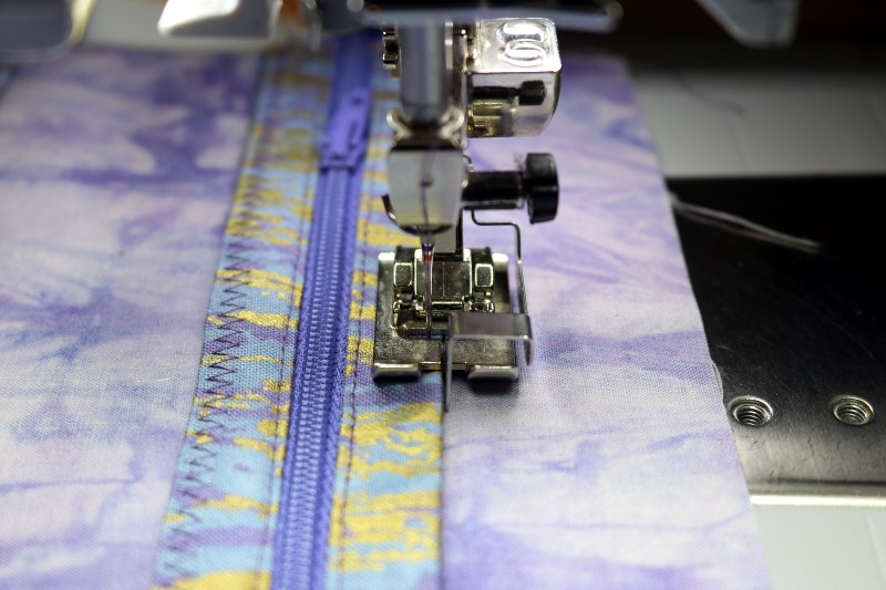 Stitch top pocket closed