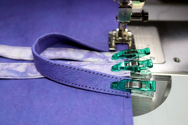 Center loop and ties then clip and stitch