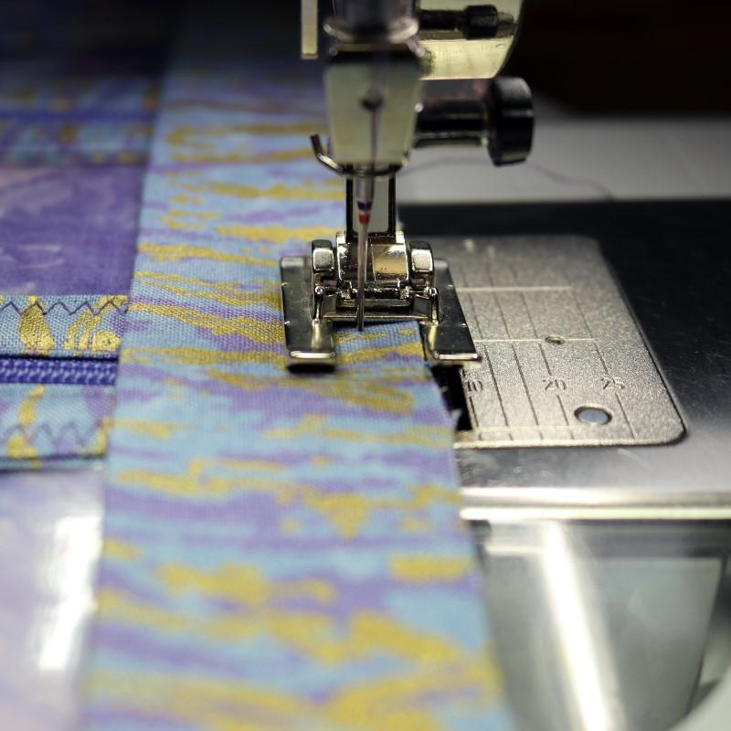 Press binding lengthwise and stitch