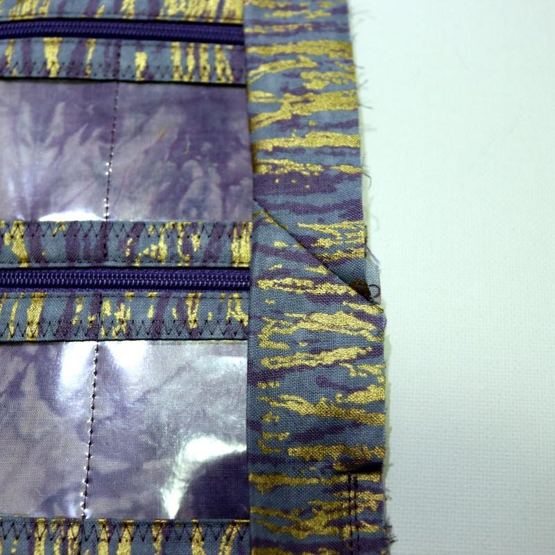 Reposition binding and finish stitching