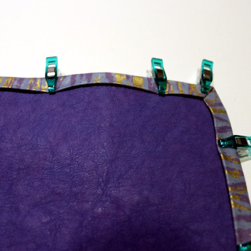 Turn binding to outside, clip and stitch