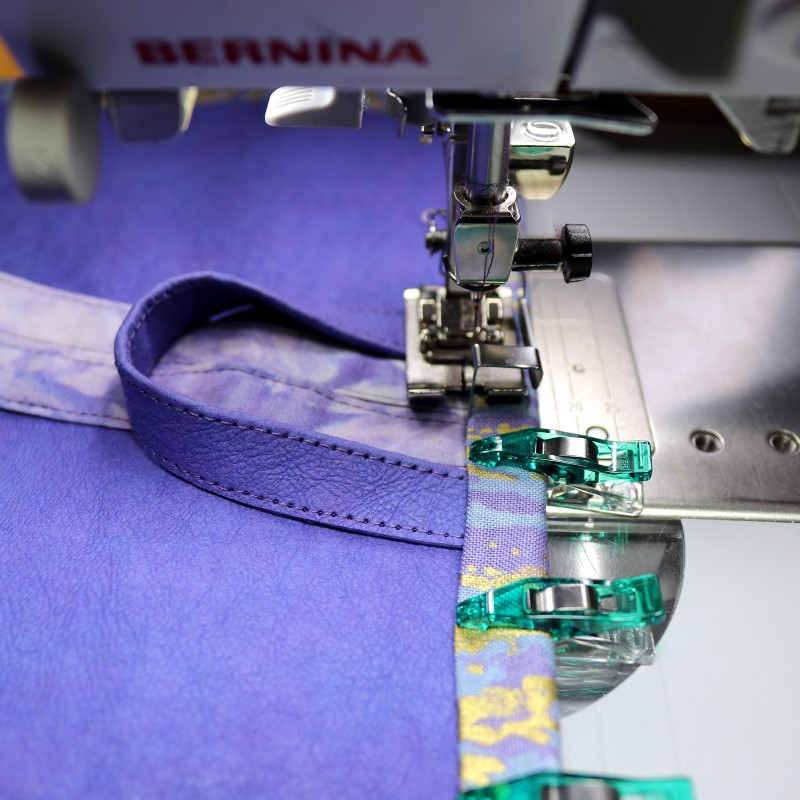 Stitch carefully over loop and ties