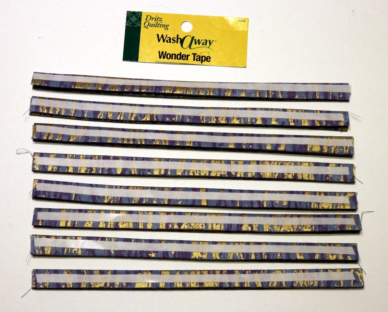 Apply Wonder Tape to one side of zipper trim