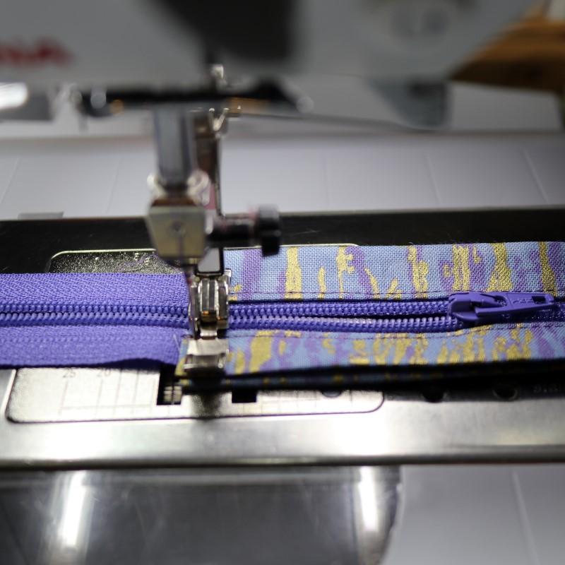 Stitch zipper ends