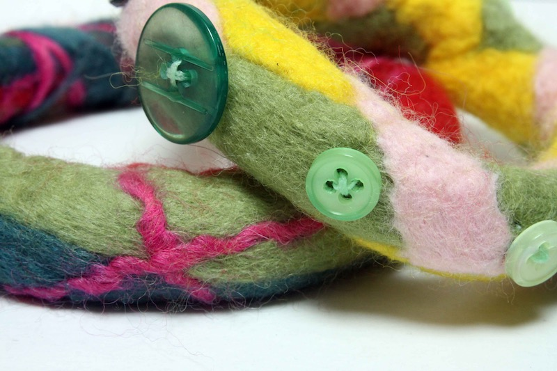 Felt bangle made from bits of yarn