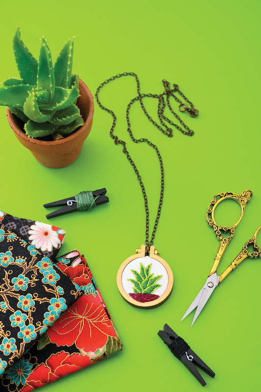 Small embroidery hoop art necklace with cactus by Megan Eckman