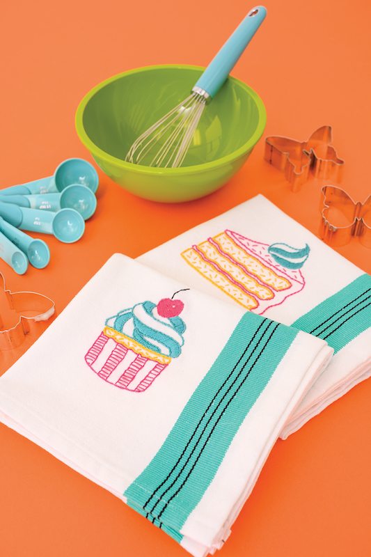 Cupcake and Cake tea towels embroidered by Megan Eckman