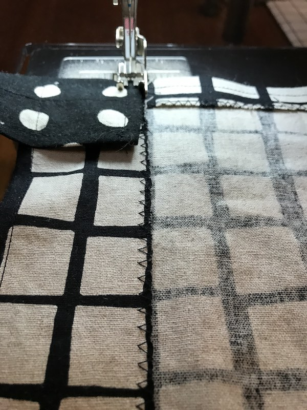 Top stitch straps to the back of the apron