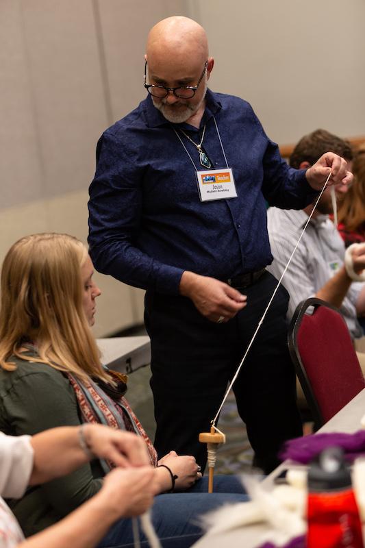 Jason teaching a drop spindle class