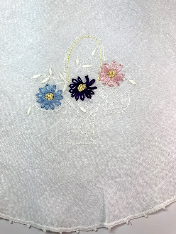 Vintage tablecloth with embroidered flowers