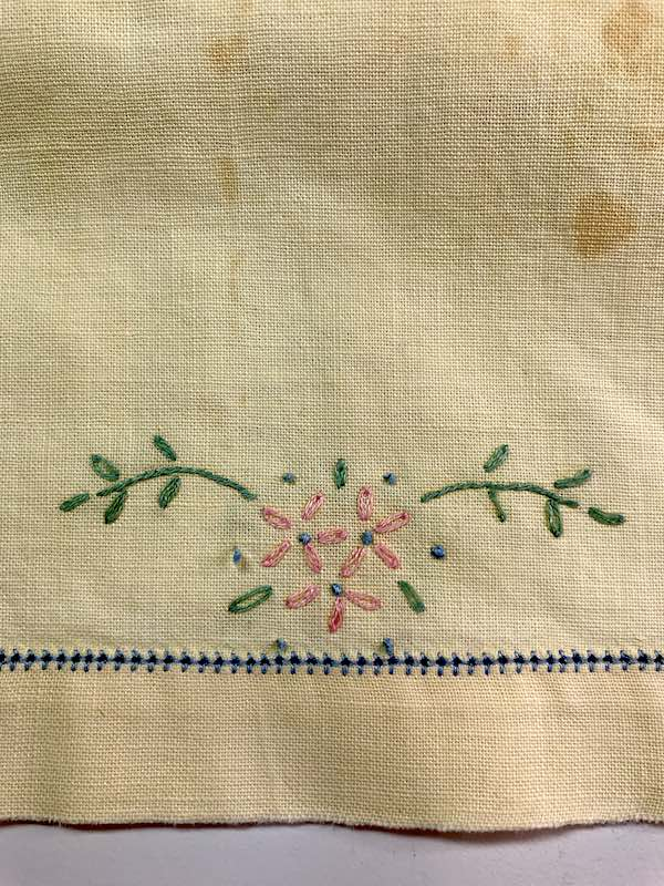Vintage hand towel with daisy stitch flowers