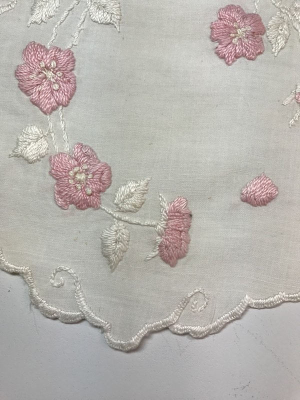 Satin stitched flowers on a vintage table linen