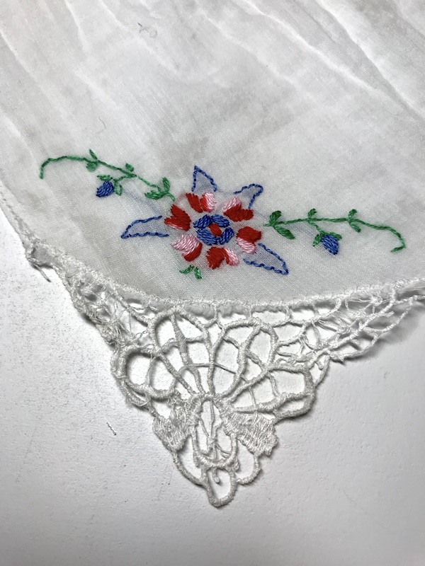 Vintage handkerchief with embroidered flowers using the satin stitch