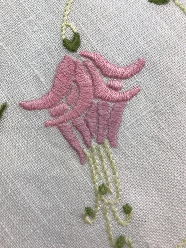 Satin stitched fuchsia on the corner of a vintage dresser cloth DETAIL