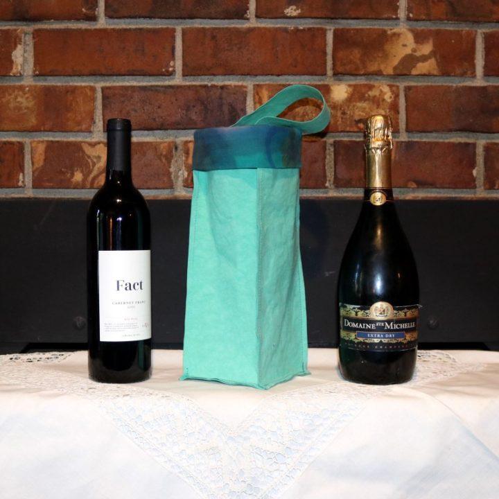 Kraft-tex Wine Bag Next to Wine and Champagne