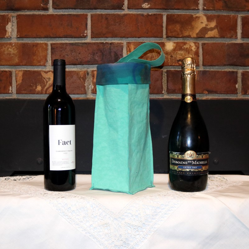 Kraft-tex Wine Bag Next to Wine and Champagne