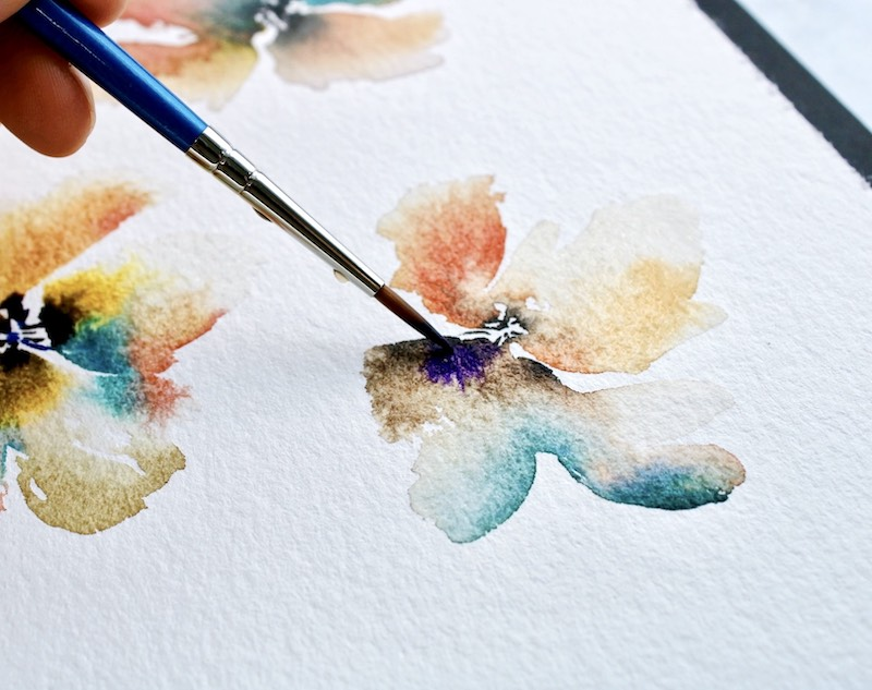Adding some dark centers to watercolor flowers