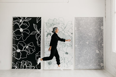 Alli Koch with her wallpaper designs