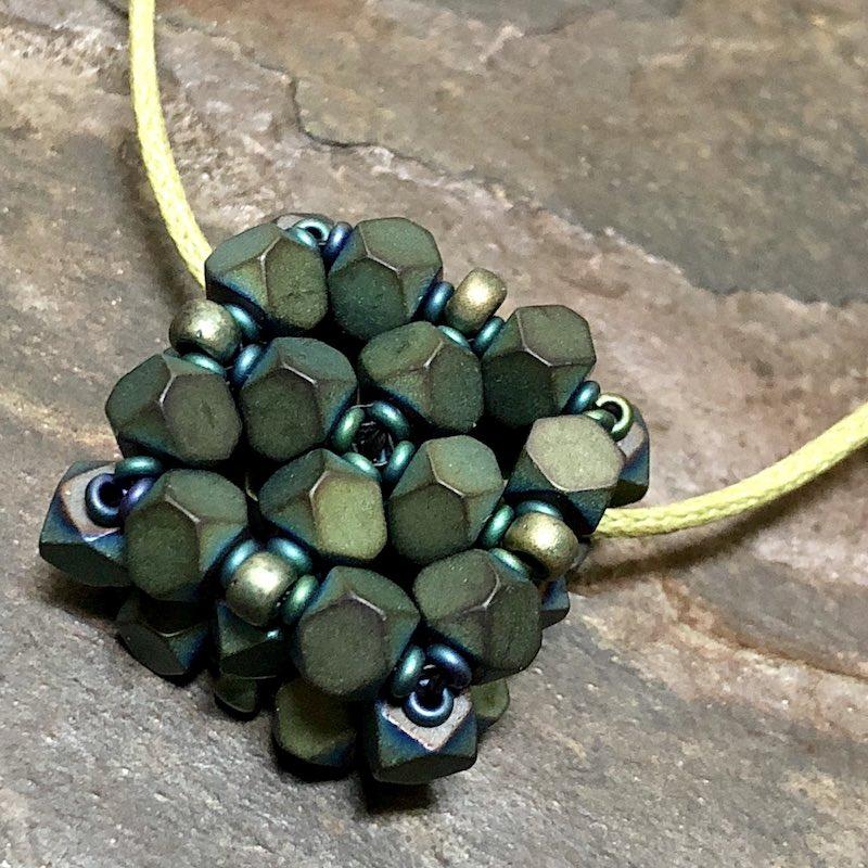Beaded bead with hematite