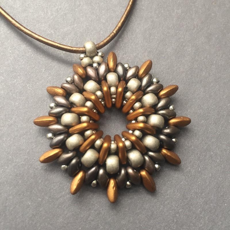 Starburst beaded pendant